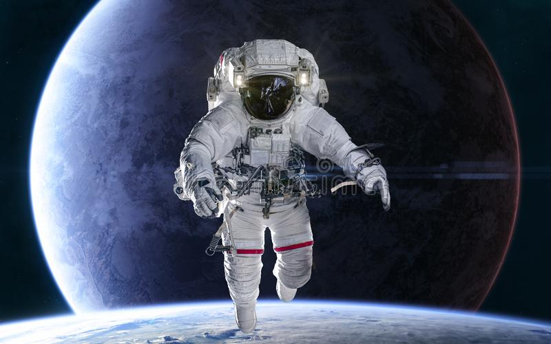 Astronaut on background of distant planets in deep space. Science fiction stock image