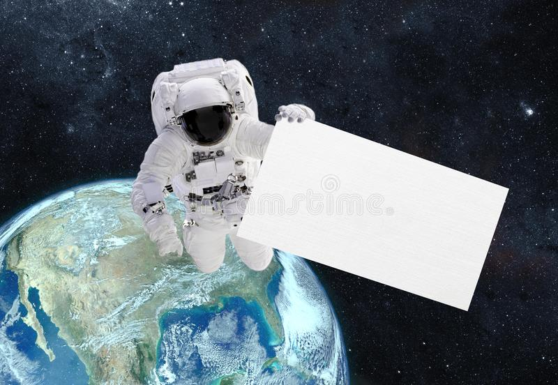 Astronaut with banner. Elements of this image furnished by NASA royalty free stock photo