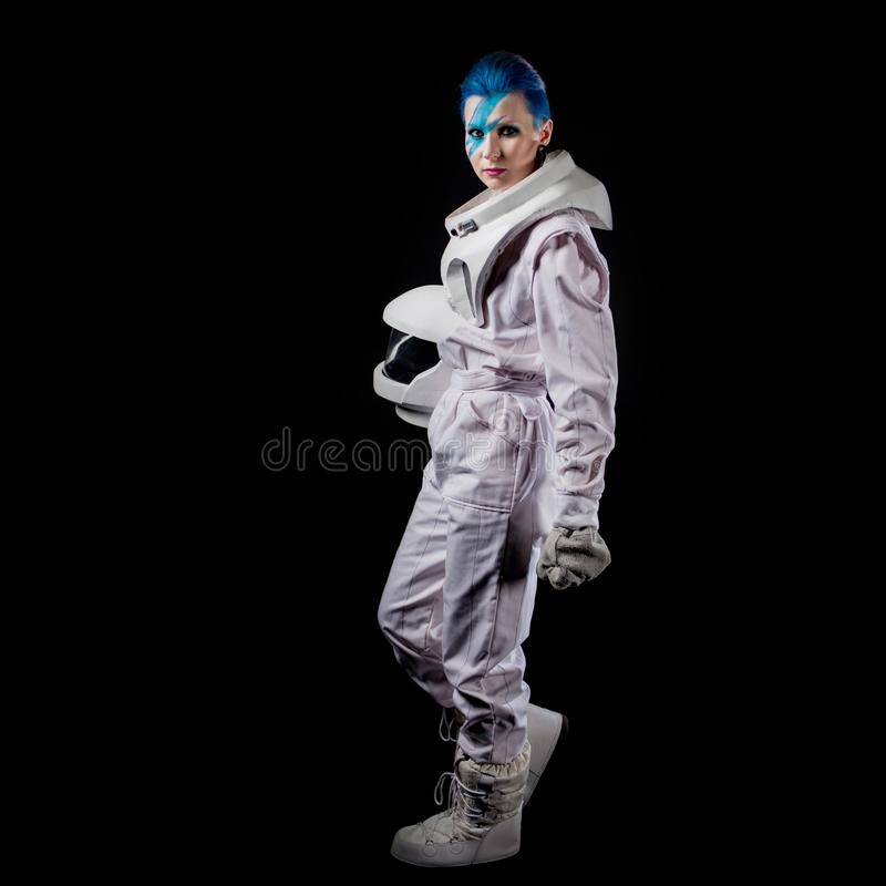 Astronaut on a black background, a young woman with face art in the space suit. Go ahead royalty free stock image
