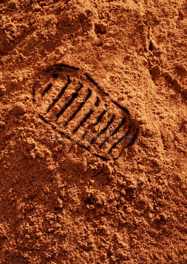 Astronaut footprint on red Martian sand stock images