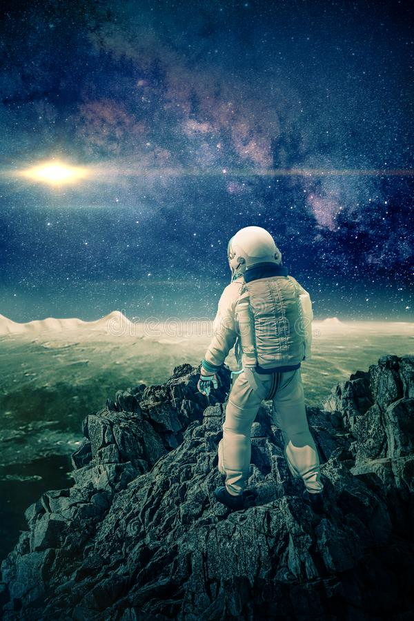 Astronaut climbs mountain on the moon -3D-Illustration stock photography