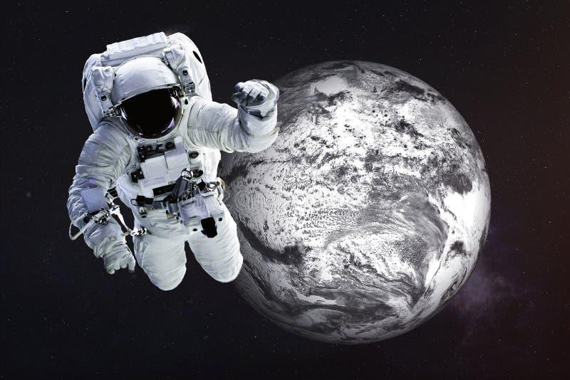 Astronaut close to the frozen Earth stock photos
