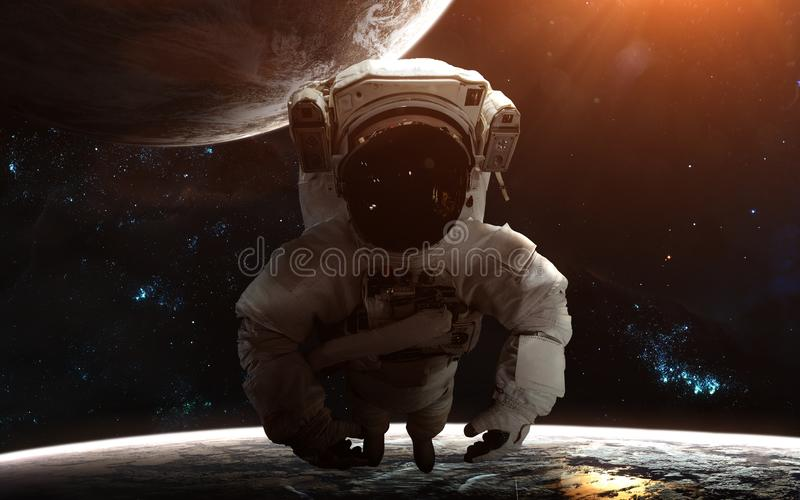 Astronaut in deep space. Planets, nebulae, star clusters. Science fiction art. Elements of the image were furnished by NASA stock photo