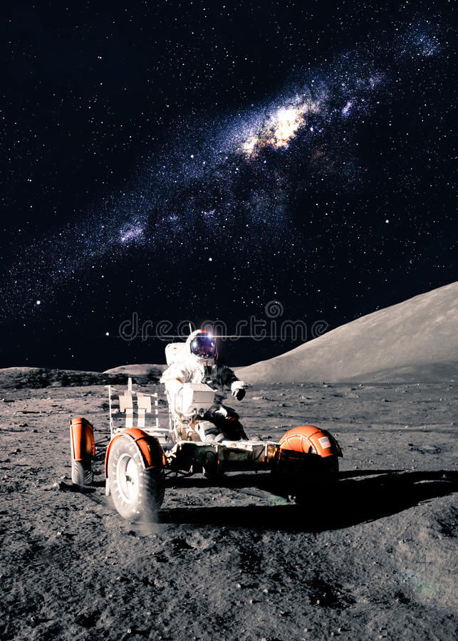 Astronaut Drives Rover stock foto's