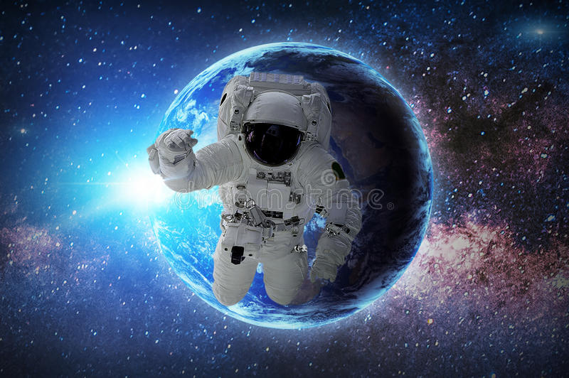 Astronaut. Elements of this image furnished by NASA. Astronaut in galaxy. Elements of this image furnished by NASA royalty free illustration