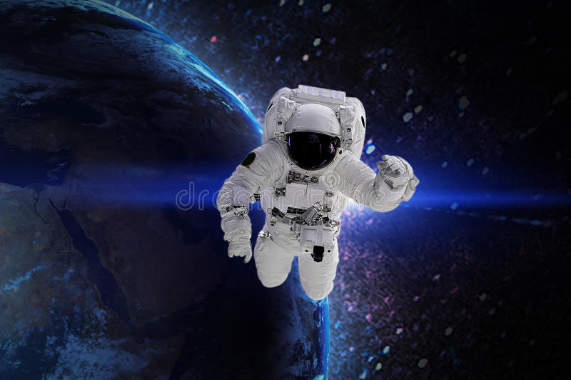 Astronaut. Elements of this image furnished by NASA. Astronaut in galaxy. Elements of this image furnished by NASA stock illustration