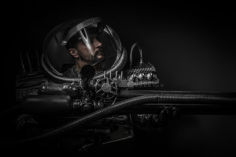 Astronaut, fantasy warrior with huge space weapon. Astronaut, fantasy warrior with huge space stock photography