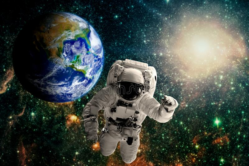 Astronaut flies over the earth in space. stock illustration