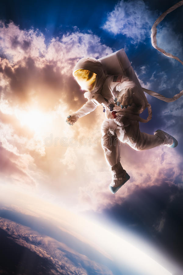 Astronaut floating in the atmosphere royalty free stock image
