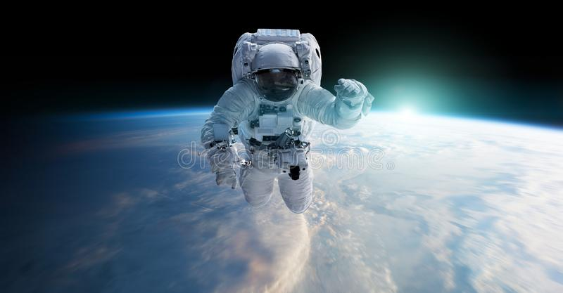 Astronaut floating in space 3D rendering elements of this image. Astronaut floating in space in front of planet Earth 3D rendering elements of this image royalty free illustration