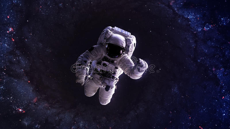 An astronaut floats above billions of stars. Stars royalty free stock image