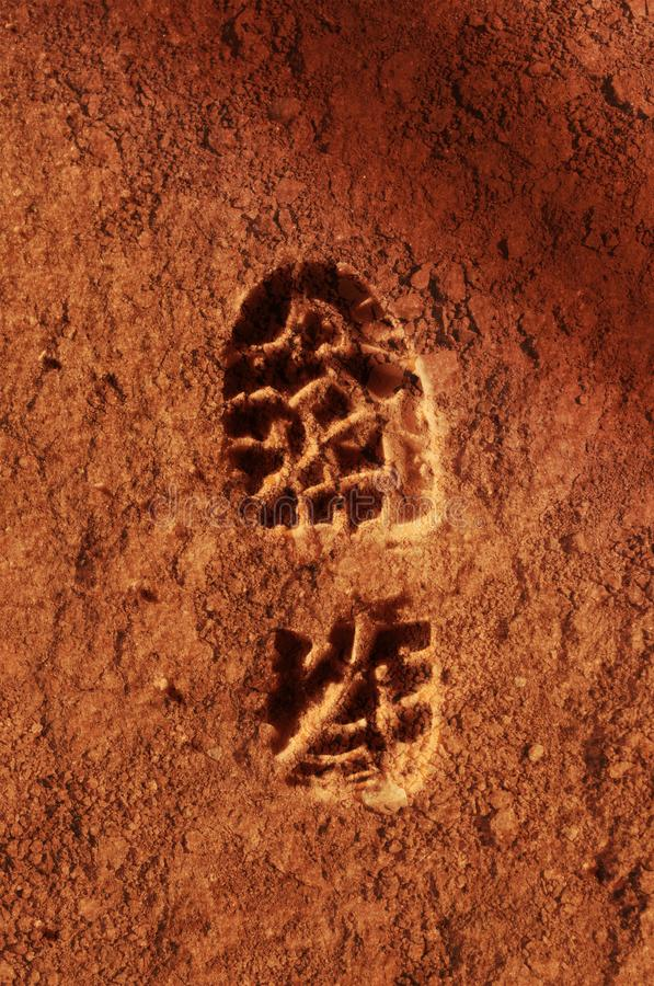 Astronaut footprint in red Martian soil stock image