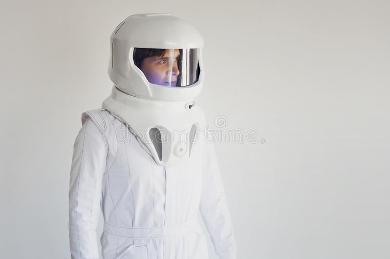 Astronaut in a helmet looking to the right. Fantastic space suit. Astronaut in helmet looking to the right. Fantastic space suit. Exploration of outer space royalty free stock photo