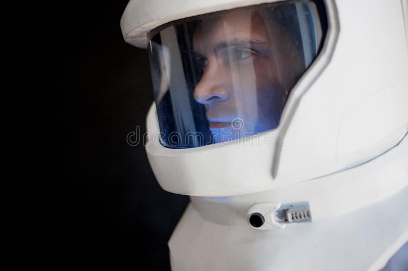 Astronaut in a helmet looks down. Fantastic space suit. Exploration of outer space. Astronaut in helmet looks down. Fantastic space suit. Exploration of outer royalty free stock photos