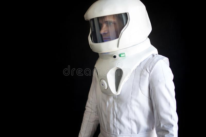 Astronaut in a helmet looks down. Fantastic space suit. Exploration of outer space. Astronaut in helmet looks down. Fantastic space suit. Exploration of outer royalty free stock photography