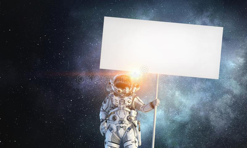 Spaceman with banner. Mixed media royalty free stock photos