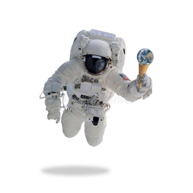 Astronaut i yttre rymd med glasskottejord arkivbilder