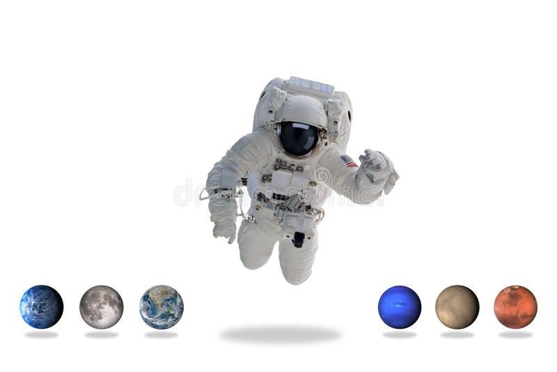 Astronaut i yttre rymd med planeter minsta konst royaltyfria foton