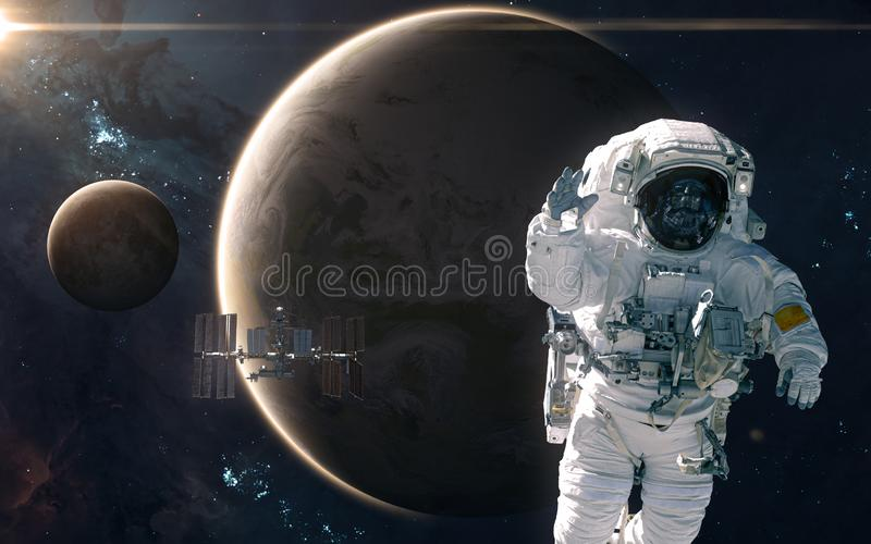 Astronaut and ISS on background of Earth and Moon. Solar system. Science fiction royalty free stock images
