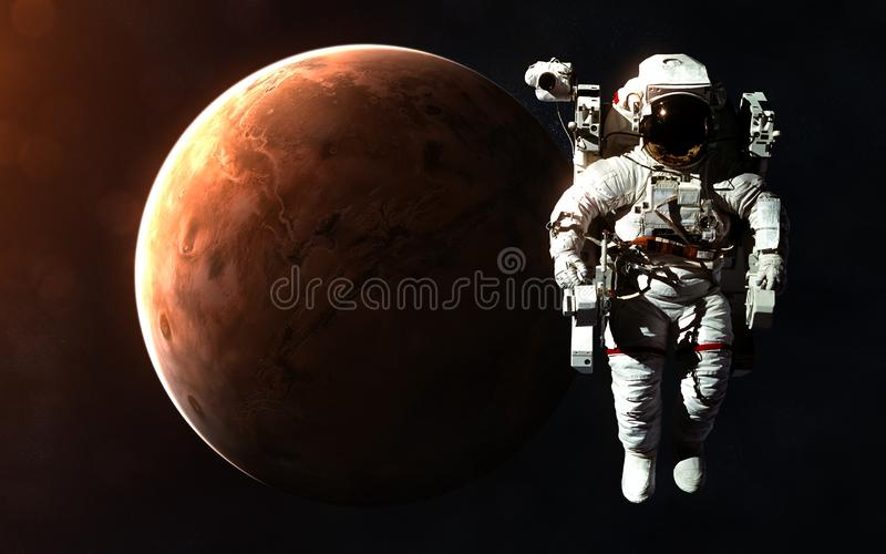 Astronaut and Mars in rays of Sun. Abstract science fiction. Elements of the image are furnished by NASA. Astronaut and Mars in rays of Sun. Abstract science royalty free stock images