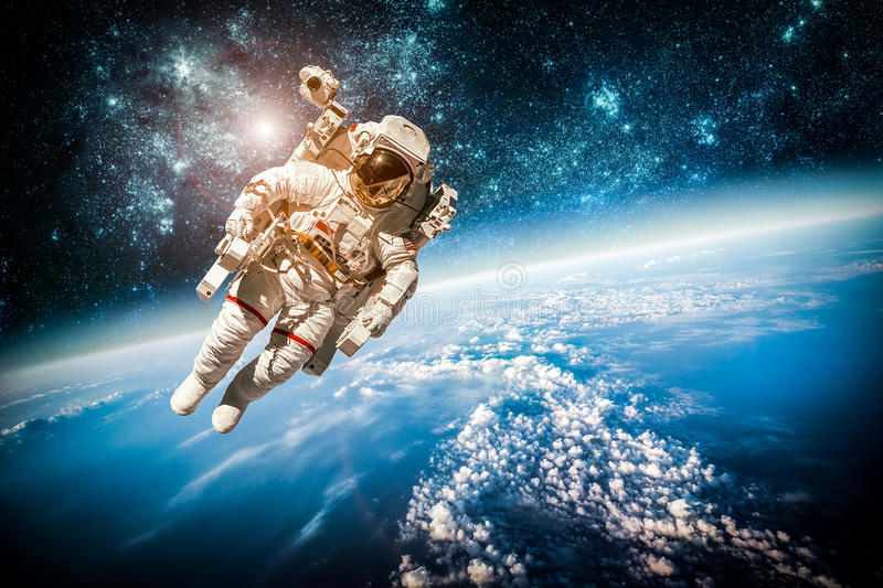 Astronaut in outer space. Against the backdrop of the planet earth. Elements of this image furnished by NASA