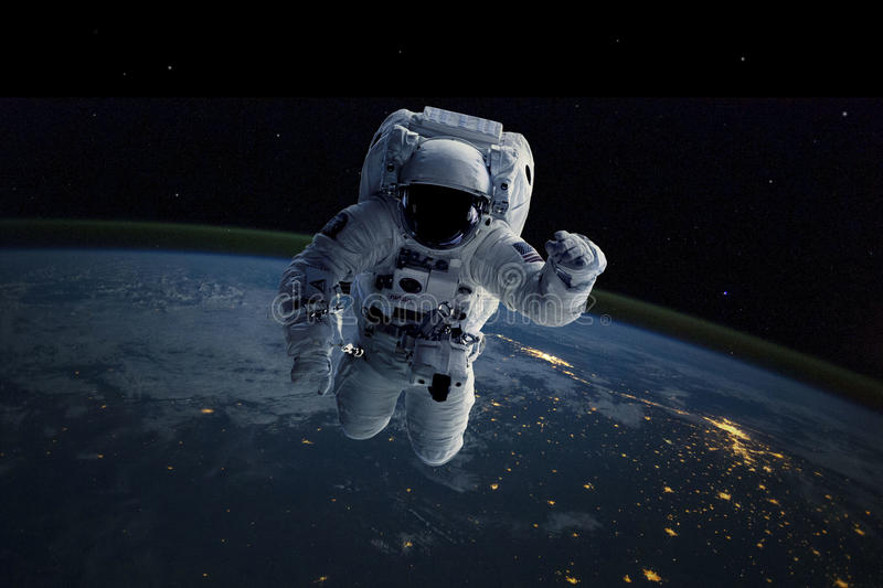 Astronaut in outer space. Background Earth. Elements of this image furnished by NASA. Astronaut in outer space. Elements of this image furnished by NASA stock photo