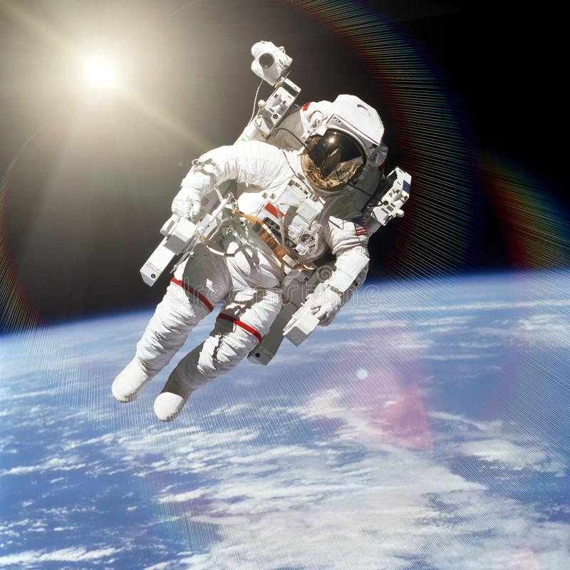 Astronaut in outer space on background of the Earth. Elements of this image furnished by NASA royalty free stock image