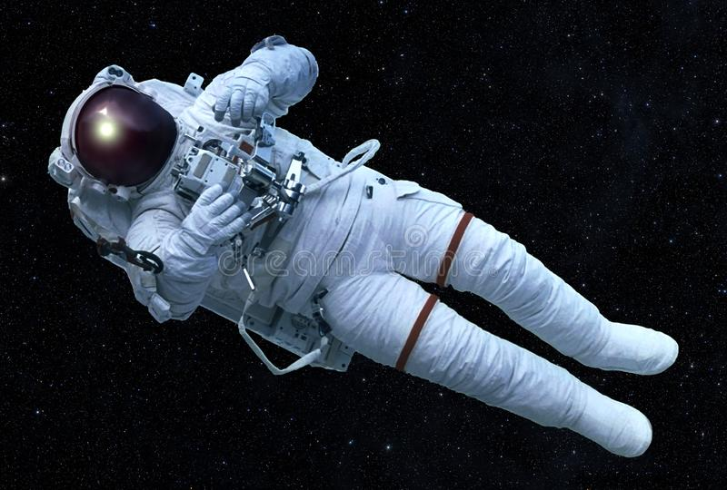The astronaut in an outer space, with the device in hands, without insurance. Elements of this image were furnished by NASA stock photo