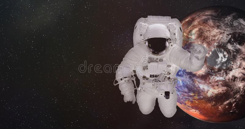 Astronaut in outer space with dying Earth. Elements of this image were furnished by NASA. royalty free stock photography