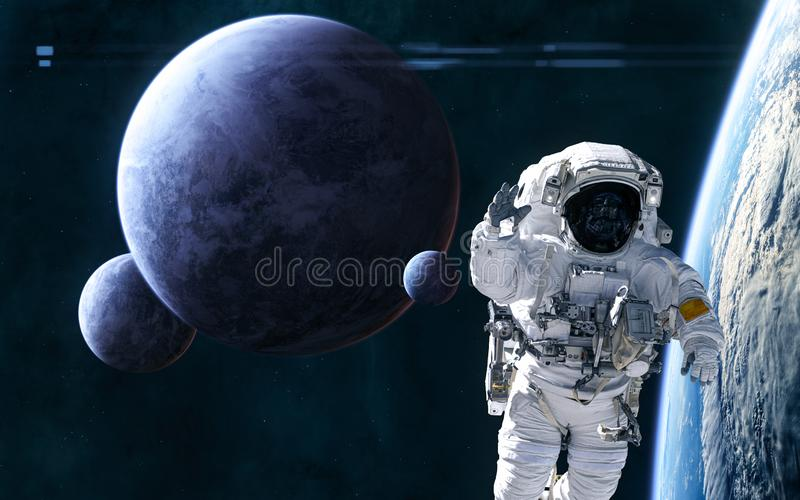 Astronaut in outer space in orbit of distant planet. Planets and satellites of deep space. Science fiction stock photography