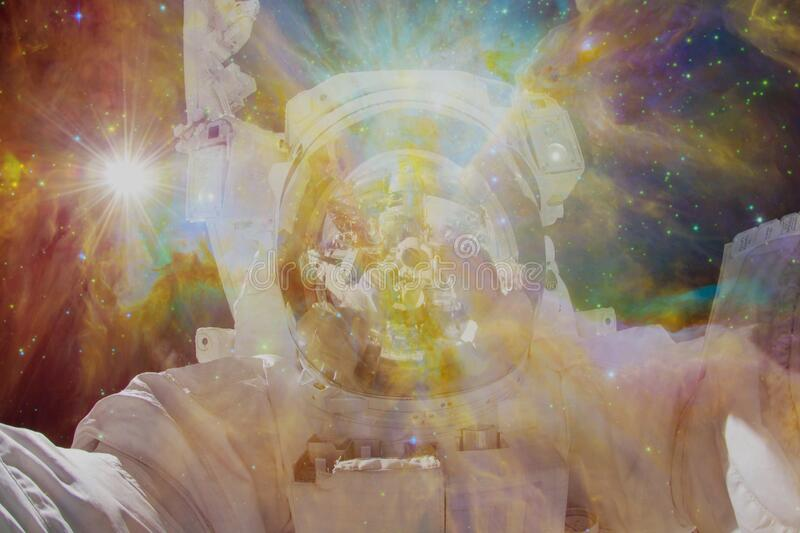 Astronaut in outer space. Elements of this image furnished by NASA stock photography