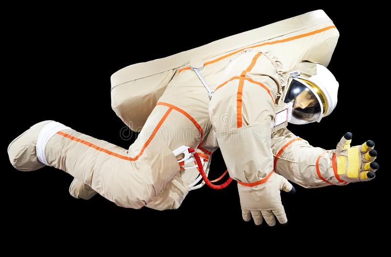Astronaut in space suit isolated black. Astronaut in modern space suit isolated black stock photos