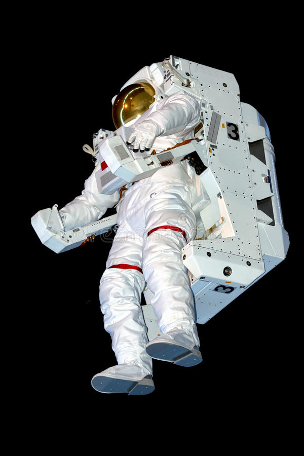 Astronaut Space Suit isolated while floating on black. Background stock image