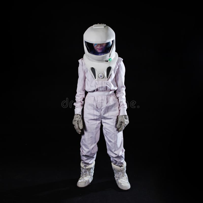 Astronaut in a space suit stands quietly among the black void. Human in space stock images