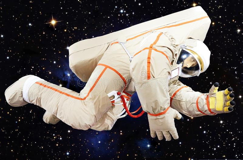 Astronaut in space suit on stars sky. Background royalty free stock image