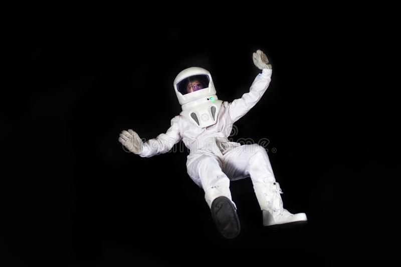 Astronaut In Space, In Zero Gravity On Black Background. Man In Space, Falling Stock Photo ...