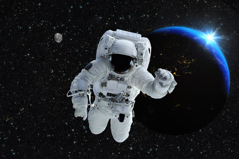 Astronaut spaceman outer space people planet earth moon. Beautiful blue sunrise. Elements of this image furnished by NASA. royalty free stock photos