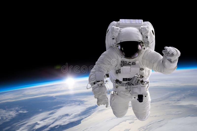 Astronaut at spacewalk stock photography