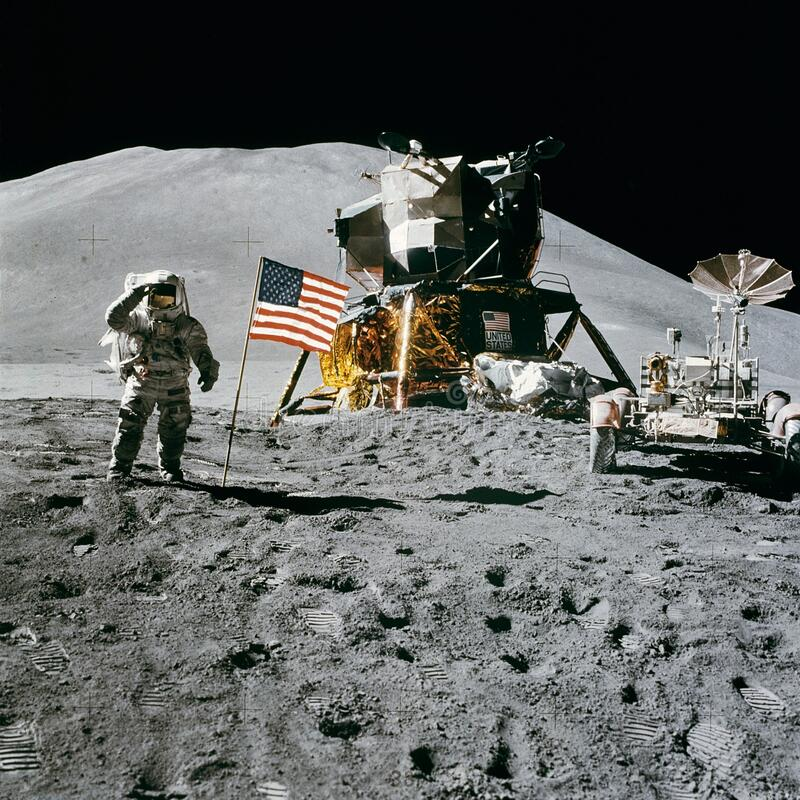 Astronaut Standing Beside American Flag on the Moon stock photo