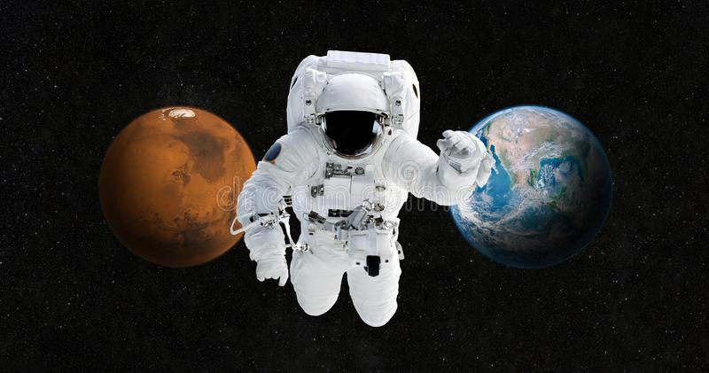 Astronaut is traveling to a new home on the planet Mars. stock images