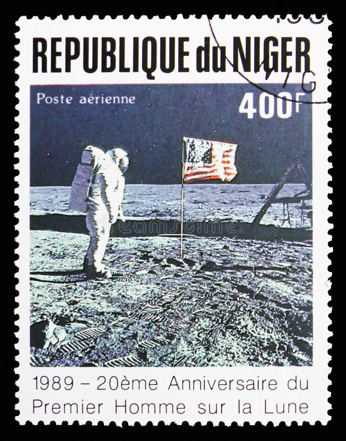 Astronaut, USA Flag, 20 Anniversary of The First Manned Landing On The Moon serie, circa 1989. MOSCOW, RUSSIA - SEPTEMBER 15, 2018: A stamp printed in Niger royalty free stock photo