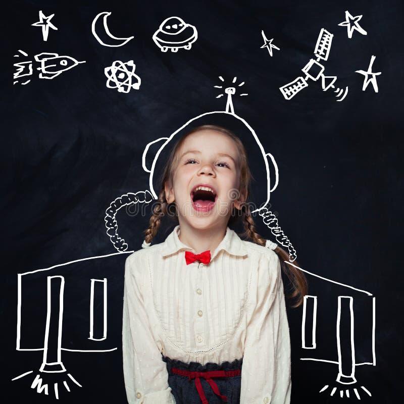 Astronauta de la niña que se divierte Embroma la imaginación fotografía de archivo libre de regalías
