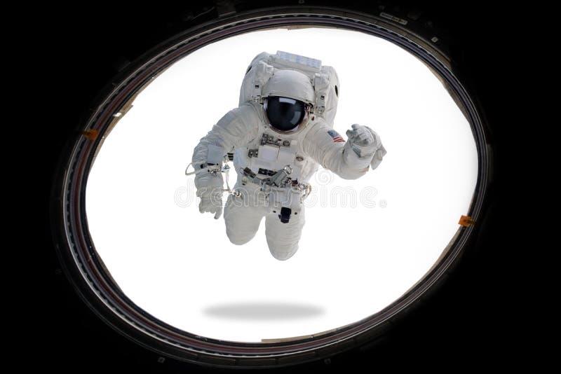 Astronauta en espacio exterior de la porta Arte mínimo fotografía de archivo