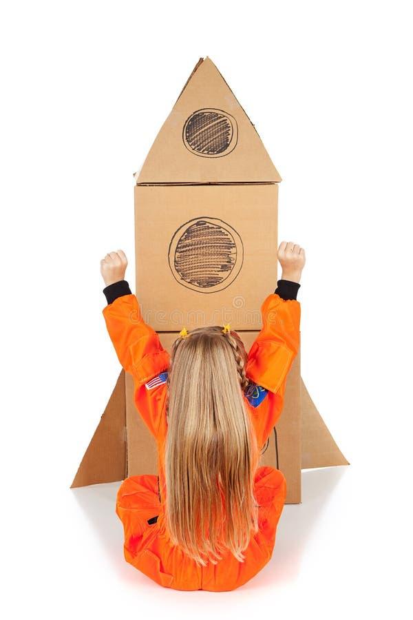Astronauta: La muchacha anima a Rocket Ship hecho en casa fotografía de archivo
