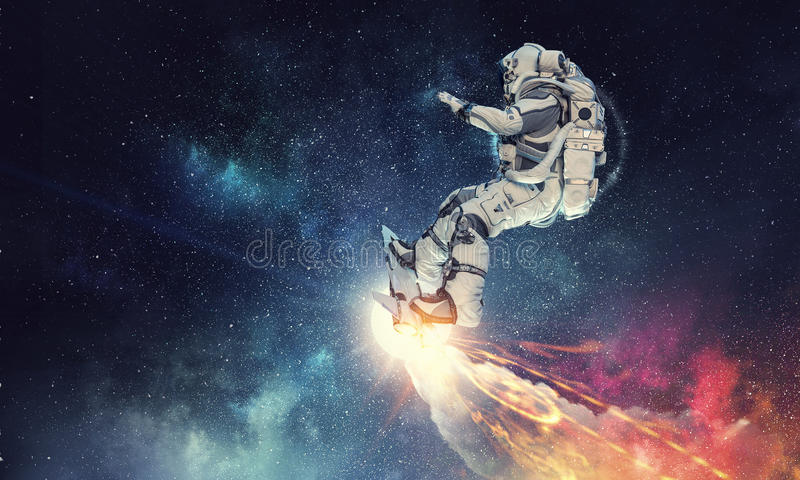 Astronauta sul bordo di volo Media misti immagini stock
