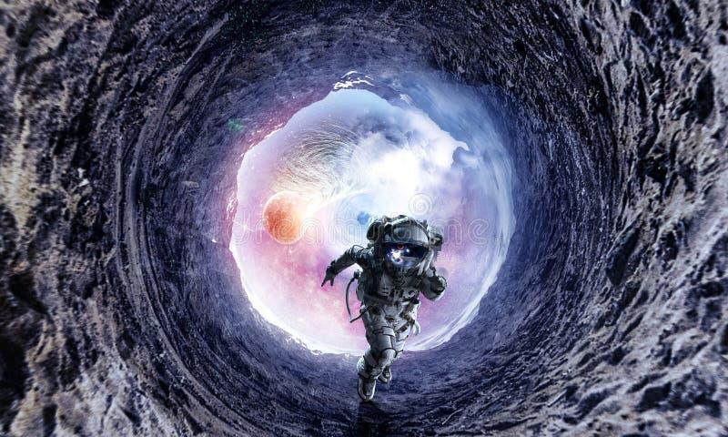 Astronauta y galaxia corrientes Técnicas mixtas imágenes de archivo libres de regalías