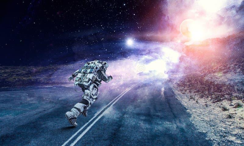 Astronauta y galaxia corrientes Técnicas mixtas fotografía de archivo