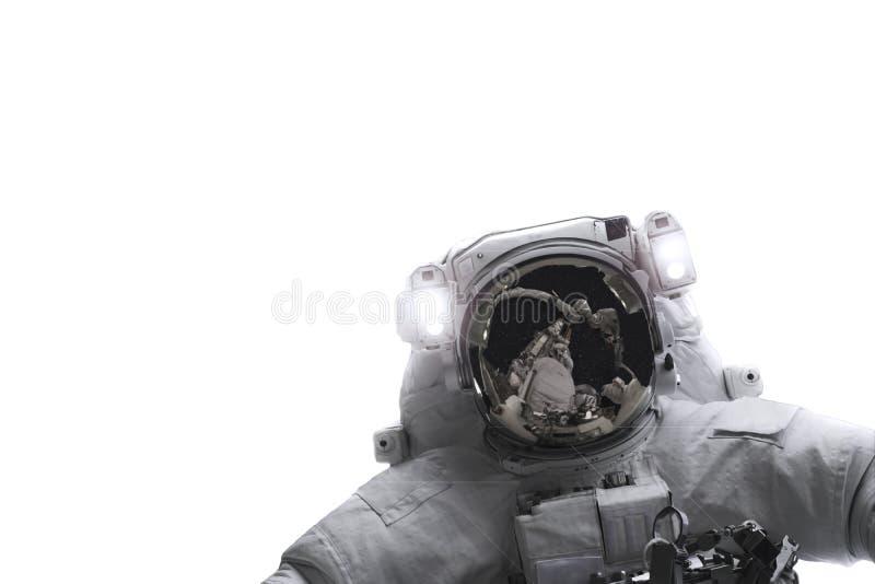 Astronaute de l'espace d'isolement sur le fond blanc Des éléments de cette image ont été fournis par la NASA image libre de droits
