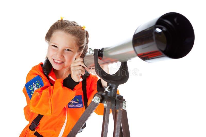 Astronaute : Regard par un télescope photographie stock
