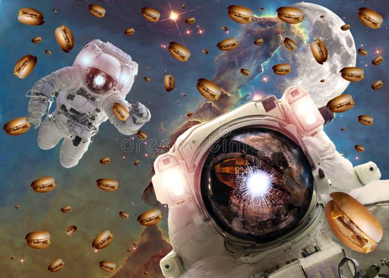 Astronauten in kosmische ruimte met cheseburgers Elementen van dit die beeld door NASA wordt geleverd stock fotografie